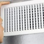 Man Peering into Vent | Dr. Crawlspace